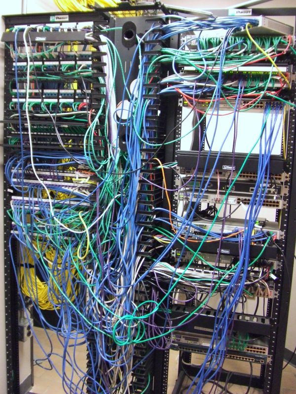 Image of disorganized networking rack
