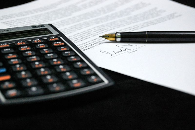 Stock photo of calcumator and letter